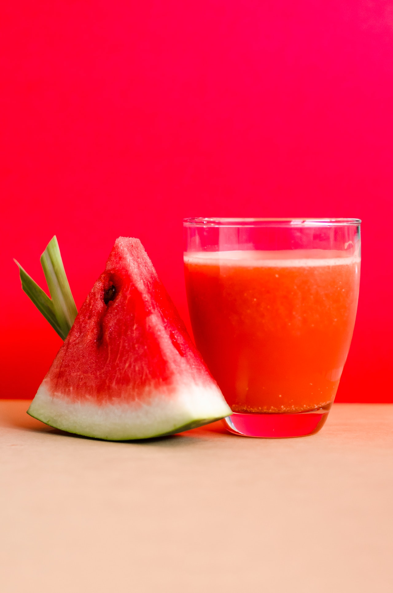 watermelon-shake-filled-glass-cup-beside-sliced-watermelon-1337825